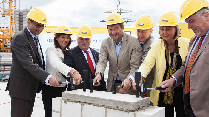 Group photo with Thomas and Tina-Maria Vlantoussi-Kaeser at the foundation stone ceremony for the new administration building